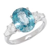 Bague sertie d'un zircon bleu et pavée de diamants, sur or blanc 14 ct