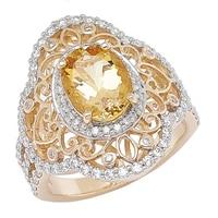 Bague parée d'une danburite ovale et de diamants sur or jaune 14 ct
