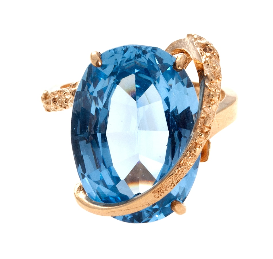 Orbital Design Ring Containing an Oval Shaped Synthetic Blue Spinel
